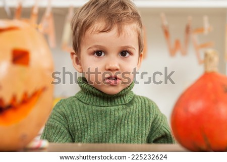 Portrait of a little boy preparing for Halloween - stock photo