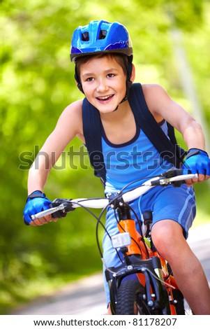 Portrait of a little boy riding a bike - stock photo