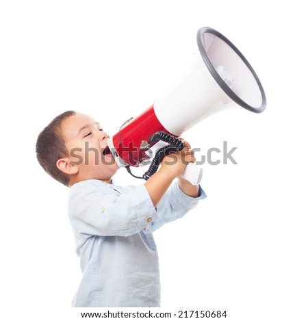 portrait of a little boy shouting on the megaphone - stock photo