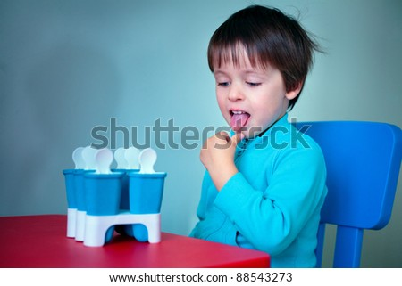 Portrait of a little boy tasting homemade ice cream - stock photo