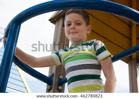 Portrait of a little boy that plays on the playground