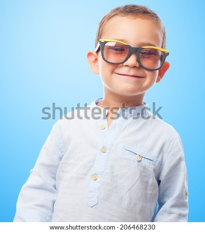 portrait of a little boy wearing retro sunglasses - stock photo