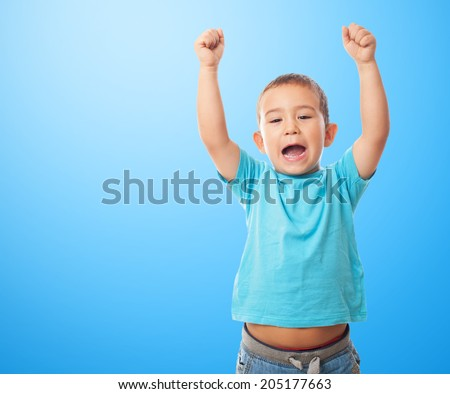 portrait of a little boy with animating gesture