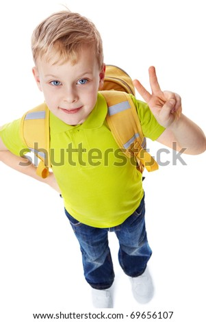 Portrait of a little boy with bag showing victory symbol - stock photo