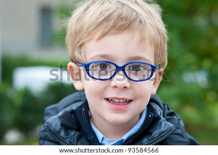 Portrait of a Little Boy with Eyeglasses - stock photo