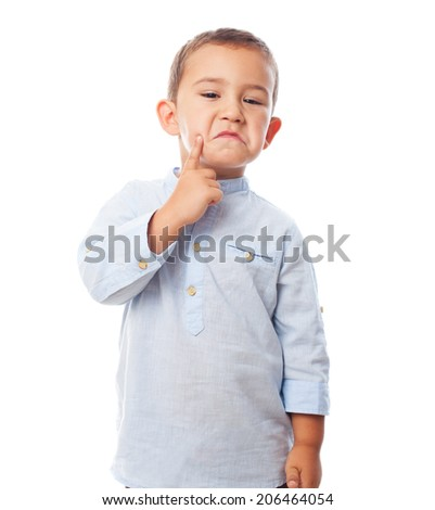 portrait of a little boy with pensive gesture - stock photo