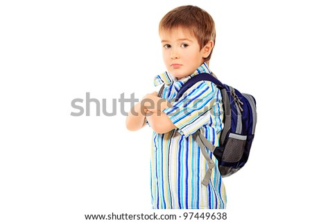 Portrait of a little boy with schoolbag. Isolated over white background. - stock photo