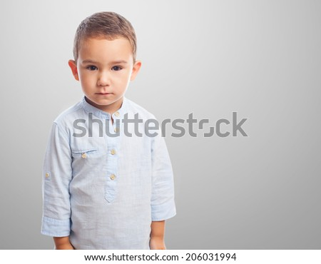 portrait of a little boy with serious gesture - stock photo