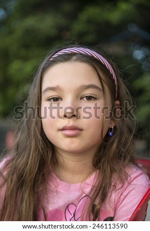 Portrait of a little brunette girl with long hair - stock photo