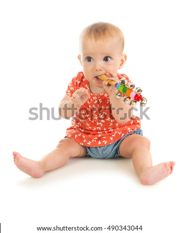 Portrait of a little cute baby girl chewing teething toy, isolated on white background