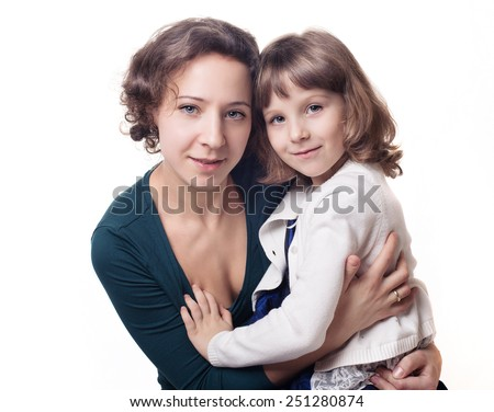 portrait of a little cute girl in beautiful clothes with her beautiful mother on white background