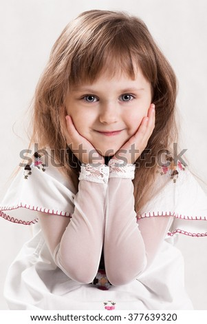 Portrait of a little girl,cute small girl.Cute little girl.Beautiful little girl with cute,lovely face,blue eyes,pure and light skin,glossy,shiny hair.Attractive girl.Happy,cheerful,smiling small girl - stock photo