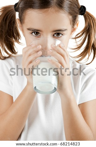 Portrait of a little girl drinking a cup of milk - stock photo