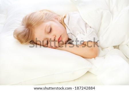 portrait of a little girl goes to bed, bed, sleep, rest  - stock photo