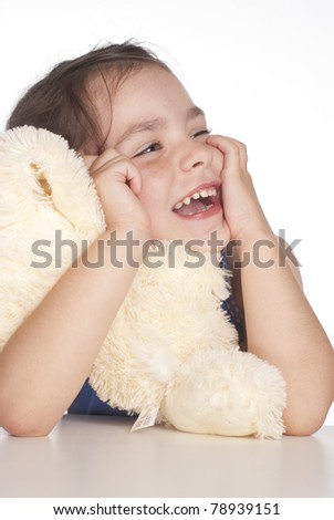portrait of a little girl holding a toy - stock photo