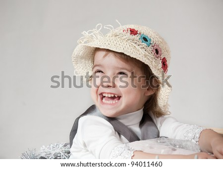 portrait of a little girl in hat on a white background