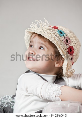 portrait of a little girl in hat on a white background - stock photo