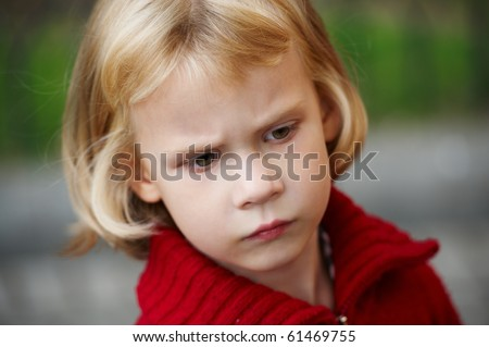 Portrait of a little girl in red sweater
