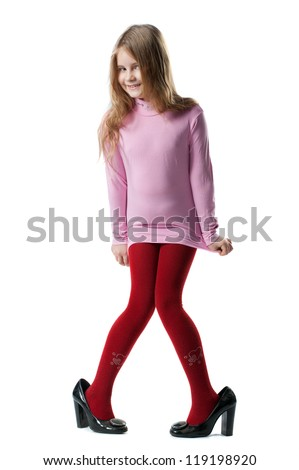 portrait of a little girl in the big of female high heels