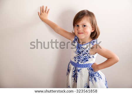 Portrait of a little girl in white-blue dress - stock photo