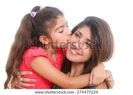 portrait of a little girl kissing her mother on a white background - stock photo