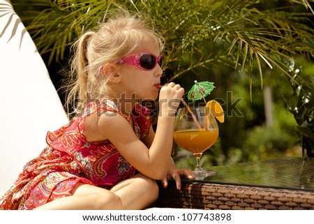 Portrait of a little girl on a deckchair