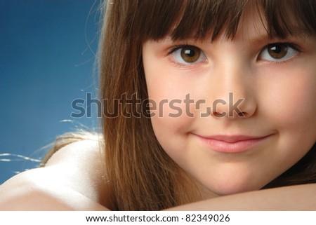 portrait of a little girl on studio shooting - stock photo