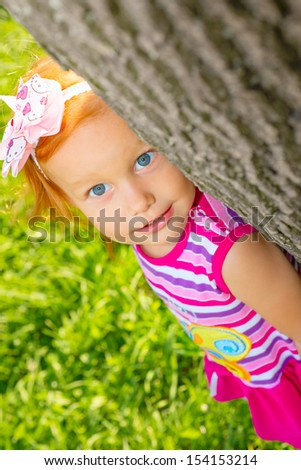 Portrait of a little girl on the nature - stock photo