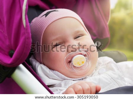 portrait of a little girl outdoors. carefree childhood.selective focus - stock photo