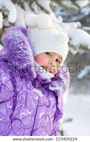 Portrait of a little girl's snow-covered tree - stock photo