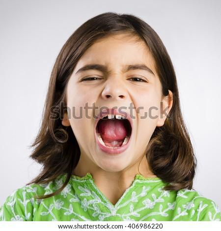 Portrait of a little girl shouting loud - stock photo