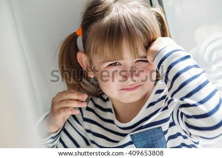 portrait of a little girl upset window - stock photo