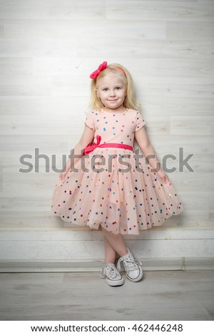 Portrait of a little girl with a beautiful dress