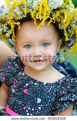 portrait of a little girl with a wreath on head - stock photo