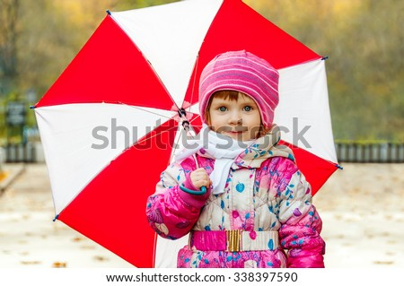 Portrait of a little girl with an umbrella - stock photo