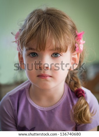 portrait of a little girl with braids - stock photo