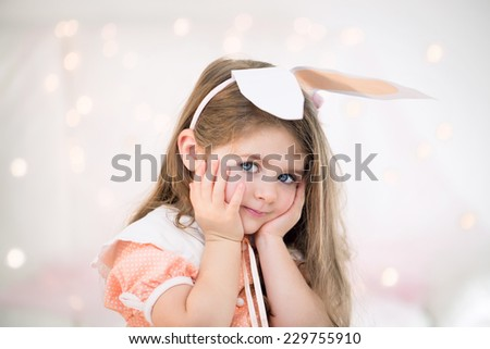 Portrait of a little girl with bunny ears.  - stock photo