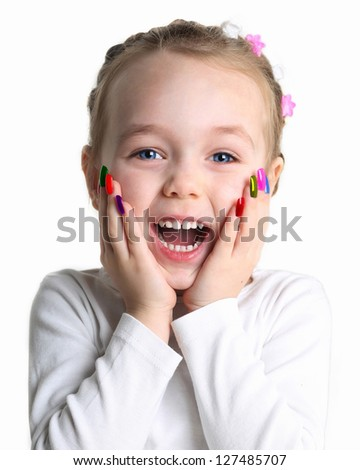 Portrait of a little girl with colorful nail polish on her hands