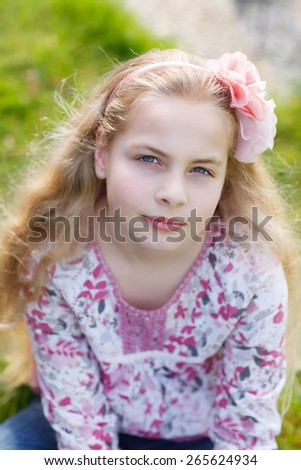portrait of a little girl with flower in her hair - stock photo