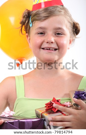 portrait of a little girl with presents - stock photo