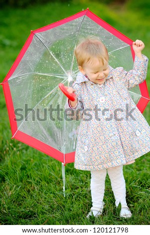 portrait of a little girl with umbrella - stock photo