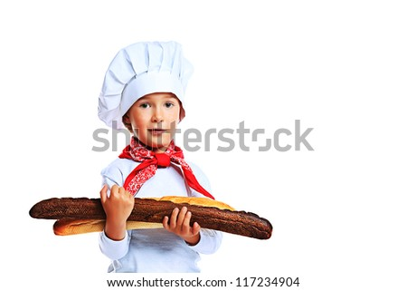 Portrait of a little kitchen boy holding french bread. Isolated over white background. - stock photo