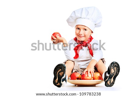 Portrait of a little kitchen boy in a white uniform. Isolated over white background. - stock photo