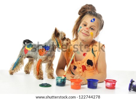 Portrait of a little messy girl painter with dog - stock photo