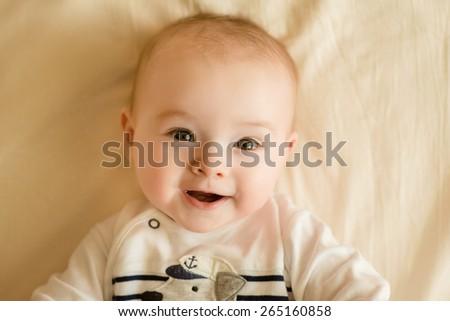 Portrait of a little smiling boy - stock photo