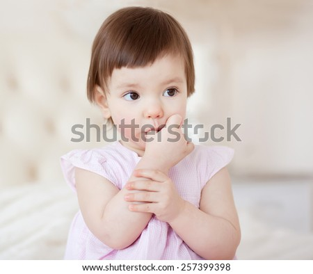 Portrait of a little sweet girl at home - stock photo
