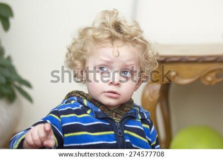 Portrait of a little worried boy - stock photo