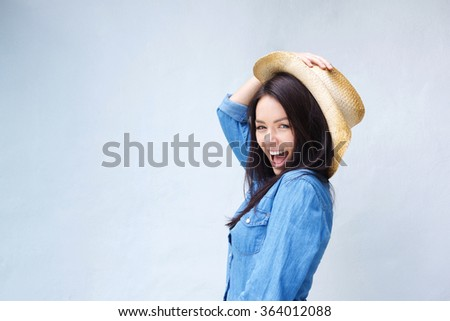 Portrait of a lively young woman laughing with cowboy hat - stock photo