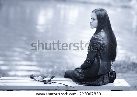 portrait of a lonely girl - stock photo