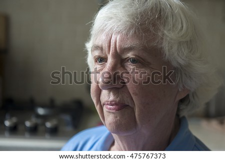 Portrait of a lonely gray-haired old woman